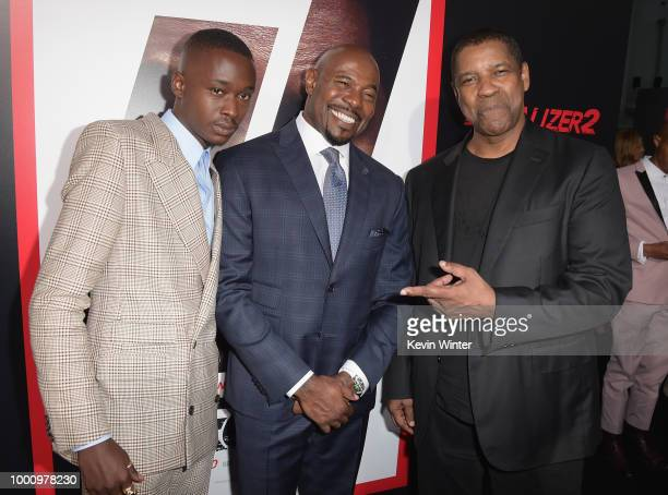 Ashton Sanders Director Antoine Fuqua and Denzel Washington attend the premiere of Columbia Picture's 'Equalizer 2' at TCL Chinese Theatre on July 17...