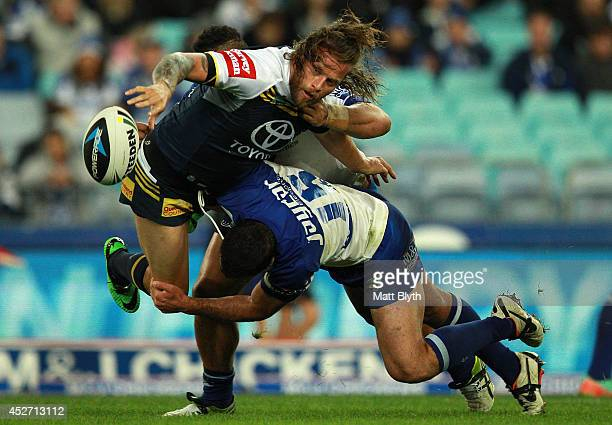 Ashton Sim of the Cowboys offloads the ball during the round 20 NRL match between the Canterbury Bulldogs and the North Queensland Cowboys at ANZ...
