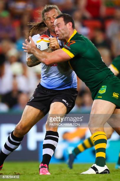 Ashton Sims of Fiji is tackled by Boyd Cordner of Australia during the Rugby League World Cup men's semifinal match between Australia and Fiji at the...