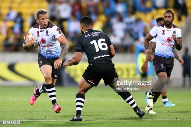 Ashton Sims of Fiji runs at Isaac Liu of the Kiwis during the 2017 Rugby League World Cup Quarter Final match between New Zealand and Fiji at...