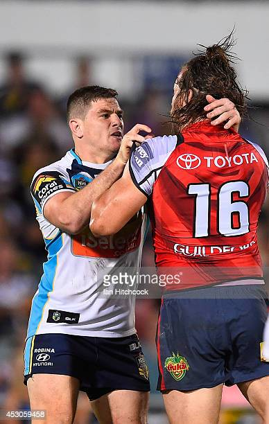 Ashton Sims of the Cowboys gets involved in a melee with Paul Carter of the Titans during the round 21 NRL match between the North Queensland Cowboys...