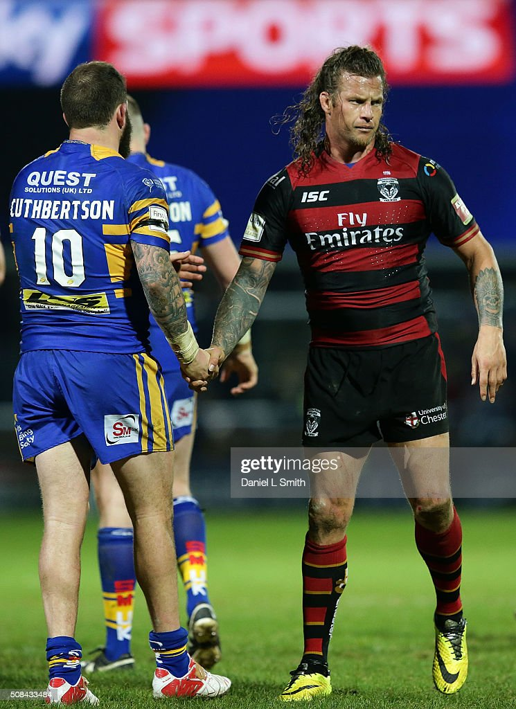Ashton Sims of Warrington Wolves congratulates Adam Cuthbertson of Leeds Rhinos after the First Utility Super League opening match between Leeds Rhinos and Warrington Wolves at Headingley Carnegie Stadium on February 4, 2016 in Leeds, England.