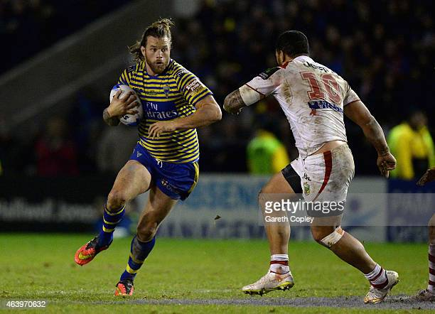 Ashton Sims of Warrington Wolves looks to get past Leeson Ah Mau of St George Illawarra Dragons during the World Club Series match between Warrington...