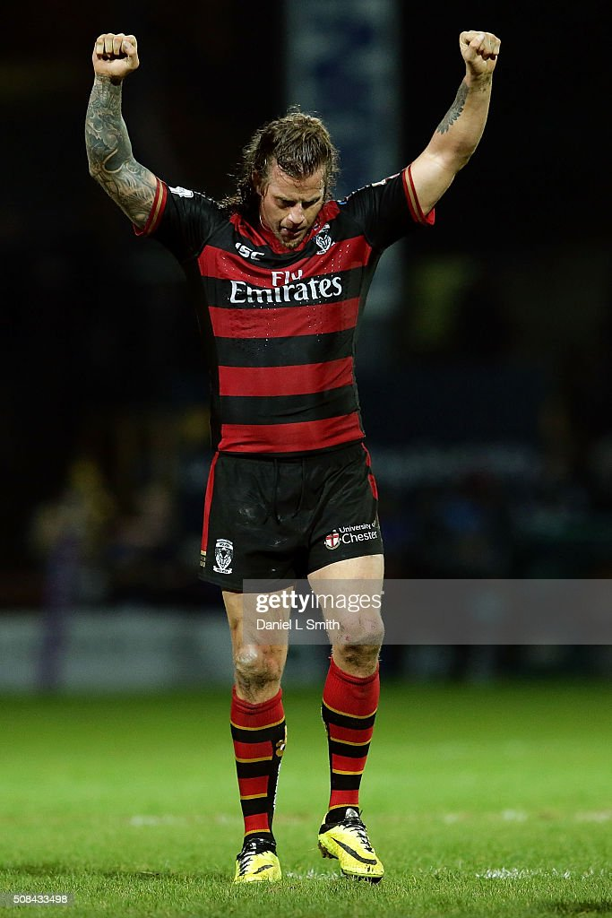 Ashton Sims of Warrington Wolves raises his hands in celebration of Warrington Wolves winning the First Utility Super League opening match between Leeds Rhinos and Warrington Wolves at Headingley Carnegie Stadium on February 4, 2016 in Leeds, England.