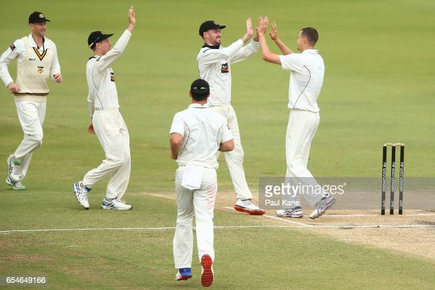 Ashton Turner and Jason Behrendorff of Western Australia celebrate the wicket of Trent Copeland of New South Wales during the Sheffield Shield match...