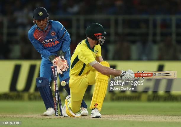 Ashton Turner of Australia is bowled by Krunal Pandya of India during game one of the T20I Series between India and Australia at ACAVDCA Stadium on...