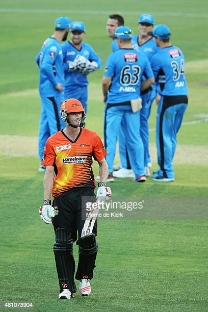 Ashton Turner of the Perth Scorchers leaves the field after getting out to Shaun Tait of the Adelaide Strikers during the Big Bash League match...