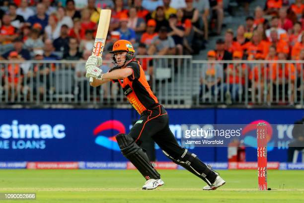 Ashton Turner of the Perth Scorchers looks on after hitting his shot during the Big Bash League match between the Perth Scorchers and the Brisbane...