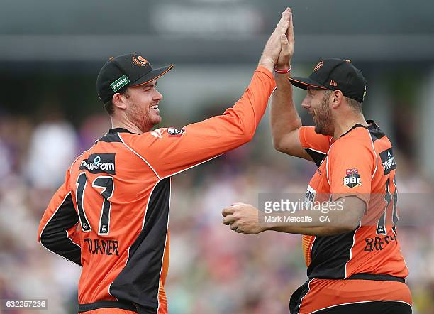 Ashton Turner of the Scorchers and Tim Bresnan of the Scorchers celebrate after taking a catch to dismiss George Bailey of the Hurricanes during the...