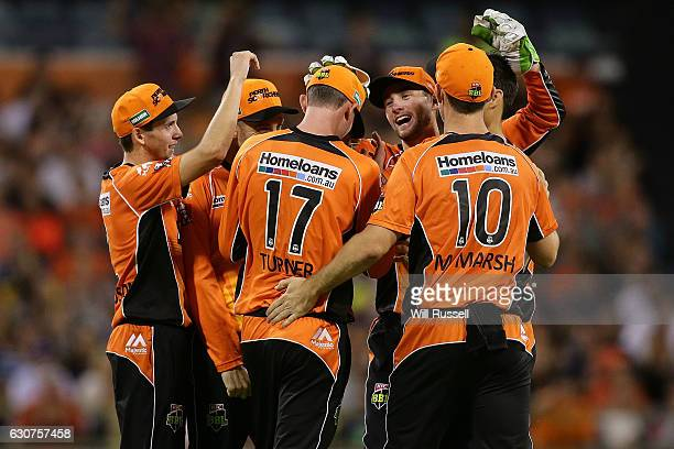 Ashton Turner of the Scorchers celebrates after taking a catch to dismiss Andre Russell of the Thunder off the bowling of Mitchell Johnson of the...