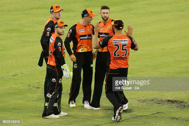 Ashton Turner of the Scorchers celebrates after taking the wicket of Marcus Harris of the Renegades during the Big Bash League match between the...