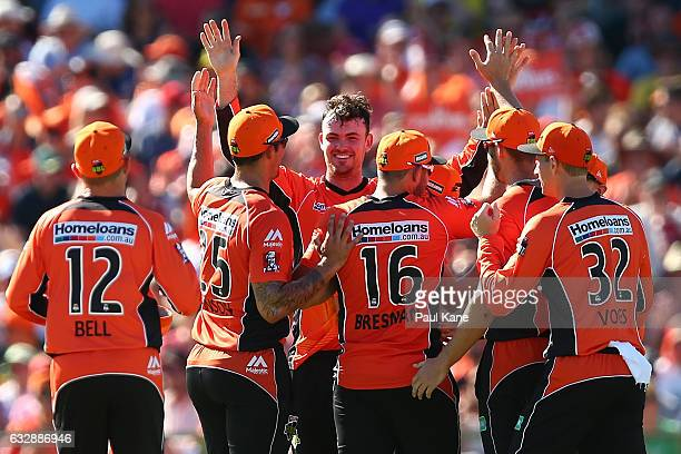 Ashton Turner of the Scorchers celebrates the wicket of Daniel Hughes of the Sixers during the Big Bash League match between the Perth Scorchers and...