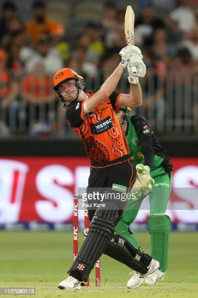 Ashton Turner of the Scorchers hits a six during the Big Bash League match between the Perth Scorchers and the Melbourne Stars at Optus Stadium on...