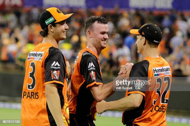 Ashton Turner of the Scorchers is congratulated by team mates after hitting the final runs to win the match during the Big Bash League match between...
