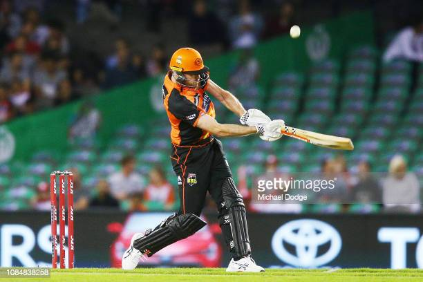 Ashton Turner of the Scorchers scores a six after the ball hit the roof during the Big Bash League match between the Melbourne Renegades and the...