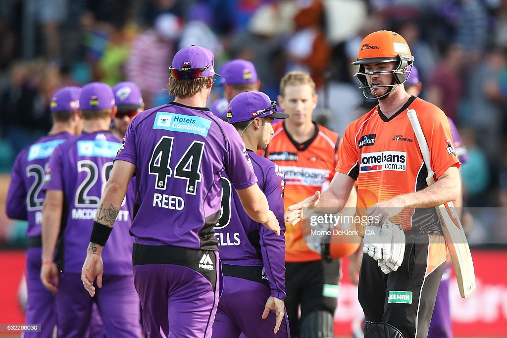Ashton Turner of the Scorchers shakes hands with Hurricanes players after the Big Bash League match between the Hobart Hurricanes and the Perth Scorchers at Blundstone Arena on January 21, 2017 in Hobart, Australia.