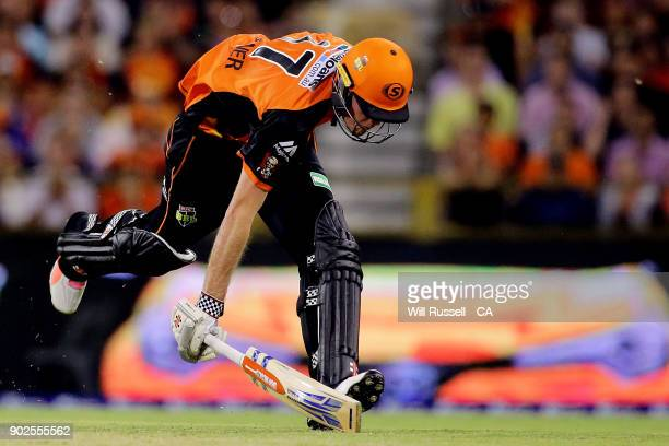 Ashton Turner of the Scorchers unsuccessfully runs for the crease during the Big Bash League match between the Perth Scorchers and the Melbourne...