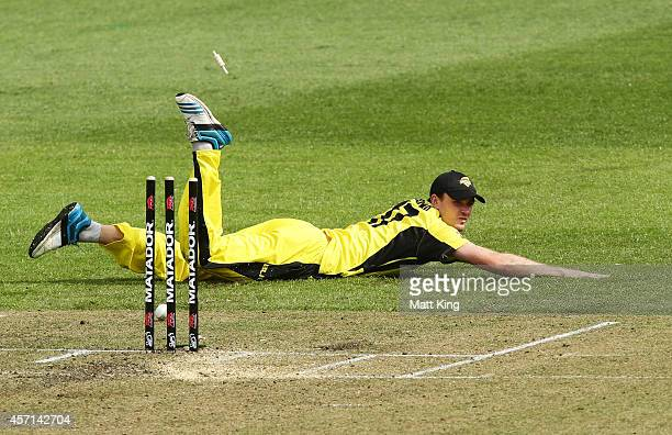 Ashton Turner of the Warriors attempts a run out during the Matador BBQs One Day Cup match between Tasmania and Western Australia at North Sydney...