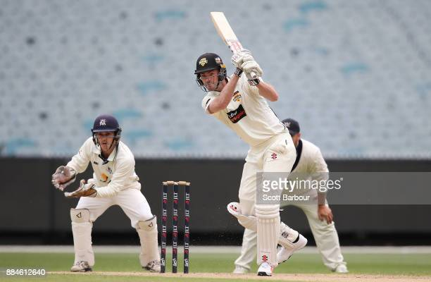 Ashton Turner of Western Australia bats as wicketkeeper Seb Gotch of Victoria looks on during day one of the Sheffield Shield match between Victoria...
