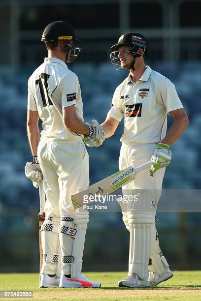 Ashton Turner of Western Australia congratulates Cameron Bancroft on scoring his 150 during day one of the Sheffield Shield match between Western...