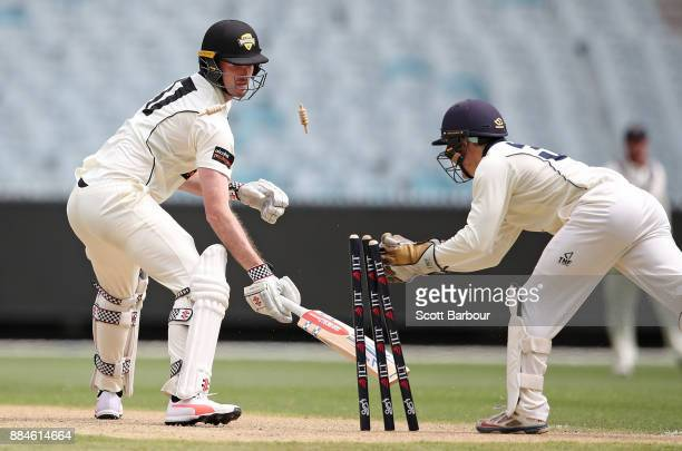 Ashton Turner of Western Australia is out stumped by wicketkeeper Seb Gotch of Victoria during day one of the Sheffield Shield match between Victoria...