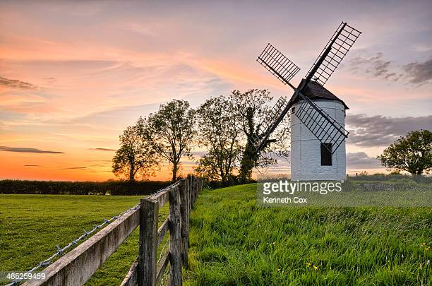 ashton windmill sunset fence field trees - somerset england stock photos and pictures