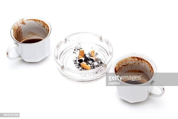 ashtray  and cups of coffee