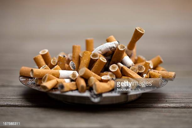 Ashtray bulging with cigarettes