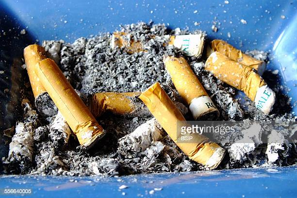 Ashtray Filled with cigarette stubs