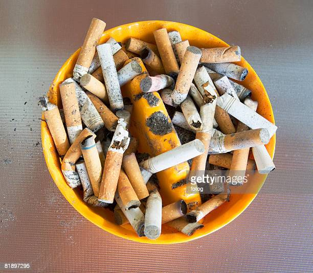 ashtray filled with many cigarette butts