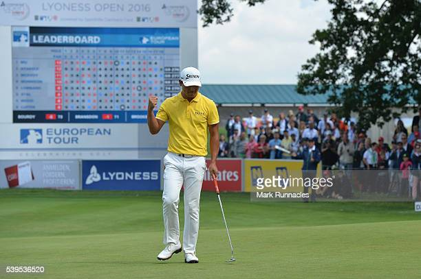 Ashun Wu of China celebrates on the 18th green after winning the Lyoness Open during the final round of the Lyoness Open at Diamond Country Club on...