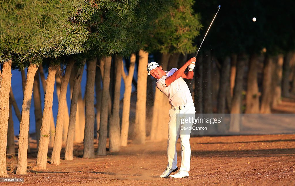 Ashun Wu of China plays his second shot at the par 5, 10th hole during the second round of the 2016 Omega Dubai Desert Classic on the Majlis Course at the Emirates Golf Club on February 5, 2016 in Dubai, United Arab Emirates.