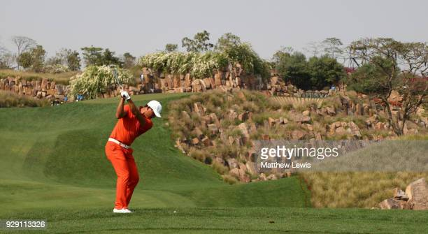 Ashun Wu of China plays his second shot on the 17th hole during day one of the Hero Indian Open at Dlf Golf and Country Club on March 8, 2018 in New...