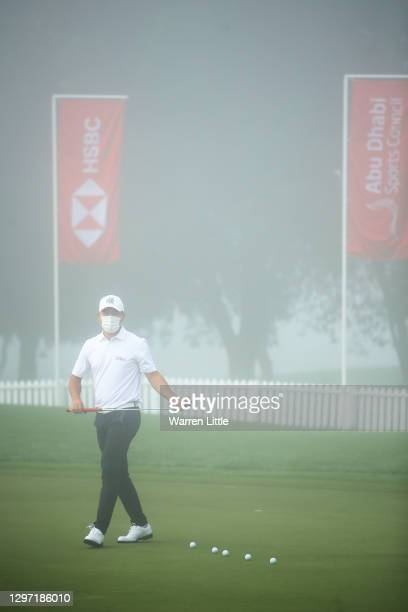 Ashun Wu of China putts on the practice green during practice ahead of the Abu Dhabi HSBC Championship at Abu Dhabi Golf Club on January 19, 2021 in...