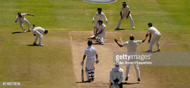 Ashwell Prince of South Africa dives to take the catch to dismiss England batsman James Anderson off the bowling of Paul Harris during the 3rd Test...
