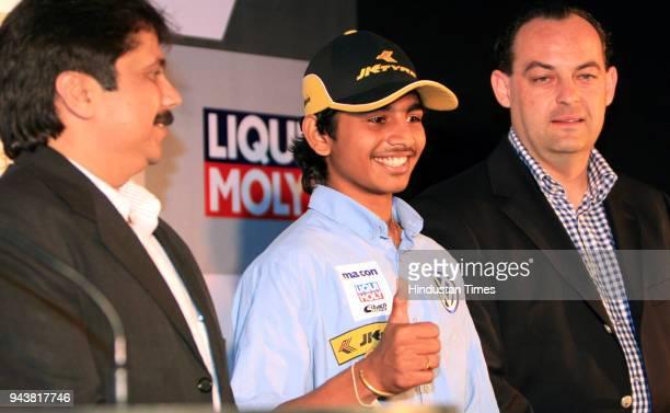 Ashwin Sundir Youngest Racing Champion Sanjay Sharma Head Motorsports JK Tyre Ltd and Marian Hamprecht Owner of the macon motorsport team during a...