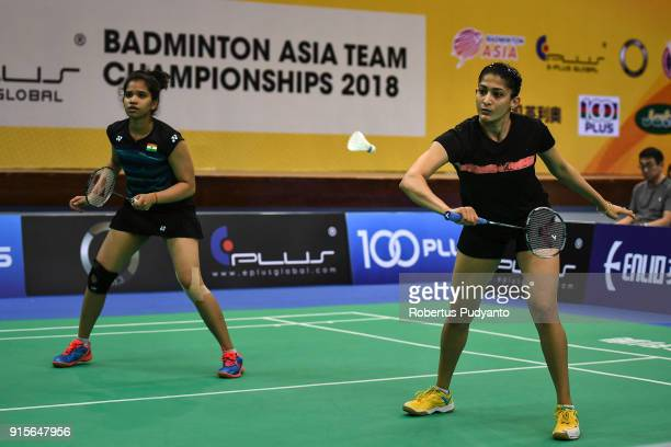 Ashwini Ponnappa and Reddy N Sikki of India compete against Misaki Matsutomo and Ayaka Takahashi of Japan during the EPlus Badminton Asia Team...