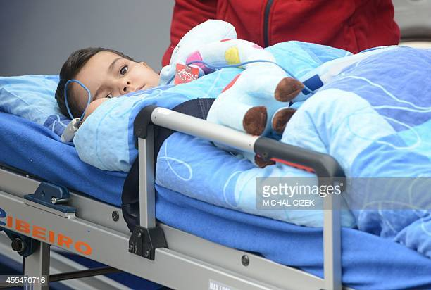Ashya King a fiveyearold British cancer patient arrives on a stretcher at the Proton Therapy Center for the start of his treatment on September 15...