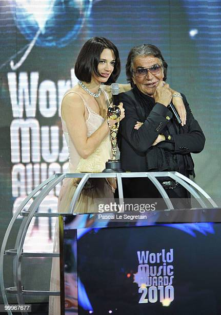 Asia Argento and designer Roberto Cavalli onstage during the World Music Awards 2010 at the Sporting Club on May 18, 2010 in Monte Carlo, Monaco.