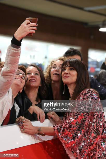 Asia Argento takes selfies with the fans on the red carpet ahead of the 'Noi Siamo Afterhours' screening during the 13th Rome Film Fest at Auditorium...