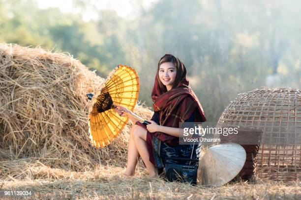 Asia beautiful woman in thai rural dress at countryside.