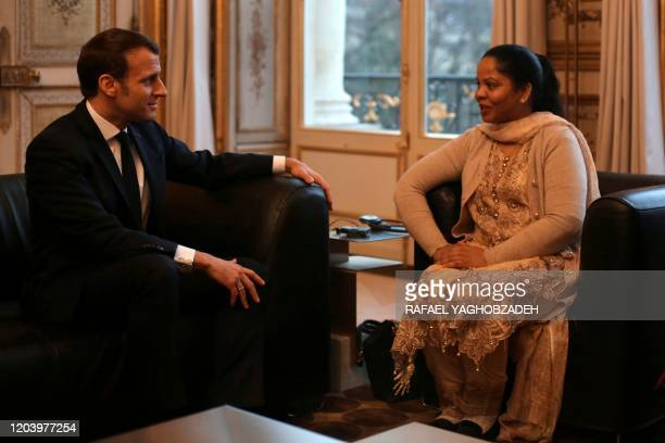 Asia Bibi, a Pakistani Christian woman, meets French President Emmanuel Macron, on February 28, 2020 at the Elysee Palace in Paris. - Asia Bibi, a...