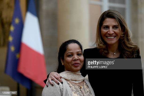 Asia Bibi, a Pakistani Christian woman, poses with French journalist Anne-Isabelle Tollet as she arrives for a meeting with French President, on...
