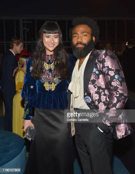 Asia Chow and Donald Glover both wearing Gucci attend the 2019 LACMA Art Film Gala Presented By Gucci at LACMA on November 02 2019 in Los Angeles...
