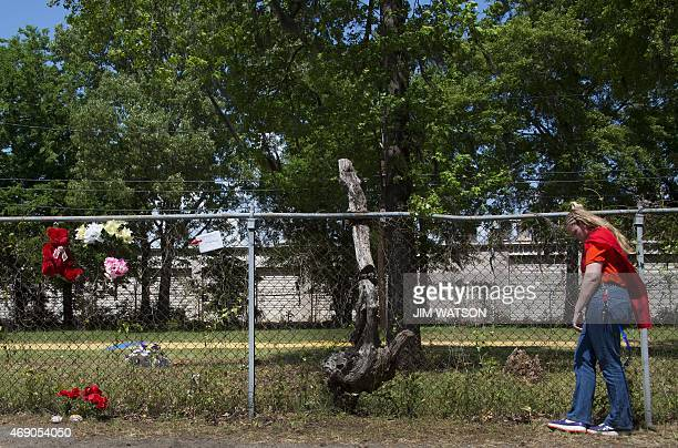 Asia Cromwell cofounder Project Street Outreach looks at the fence near a vacant lot to the area where Walter Scott was killed in North Charleston SC...