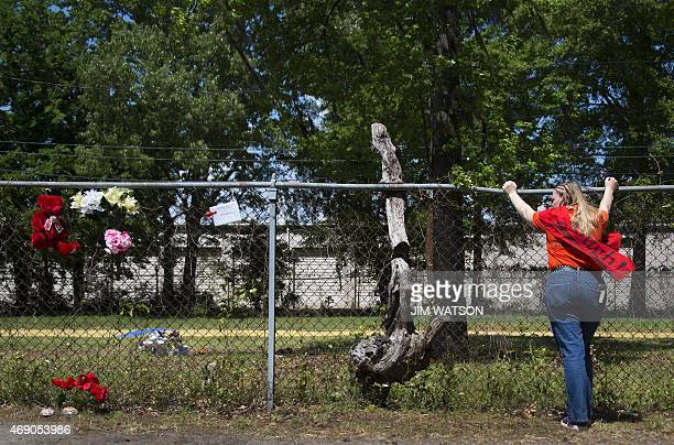Asia Cromwell cofounder Project Street Outreach looks over the fence at a vacant lot to the area where Walter Scott was killed in North Charleston SC...