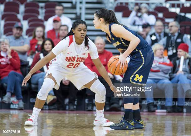 Asia Doss of the Ohio State Buckeyes gourds Katelynn Flaherty of the Michigan Wolverines as she controls the ball during the game between the Ohio...