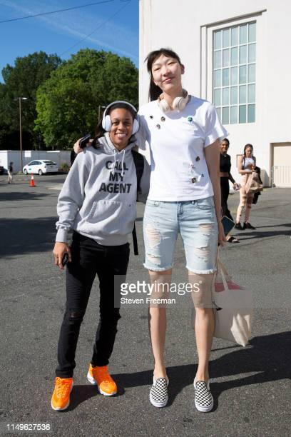 Asia Durr and Han Xu of New York Liberty arrive at the arena before the game against the Minnesota Lynx on May 8 2019 at the Westchester County...