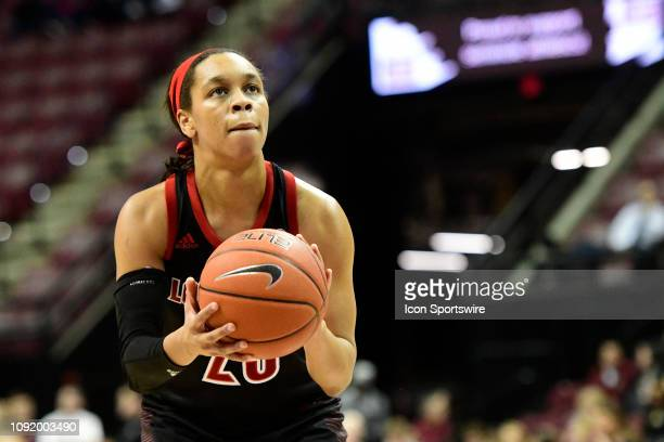Asia Durr guard Louisville Cardinals attempts a free throw against the Florida State University Seminoles in an Atlantic Coast Conference matchup...