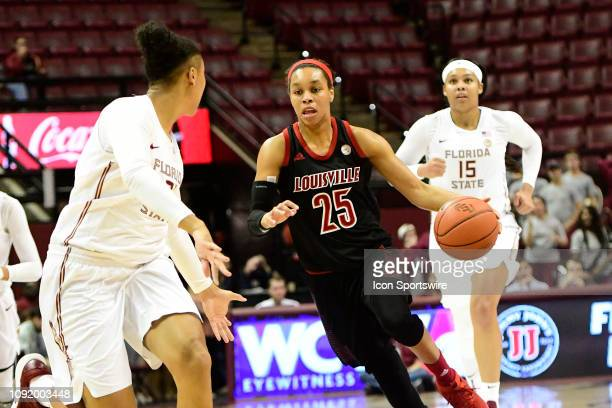 Asia Durr guard Louisville Cardinals dribbles the basketball across midcourt against the Florida State University Seminoles in an Atlantic Coast...